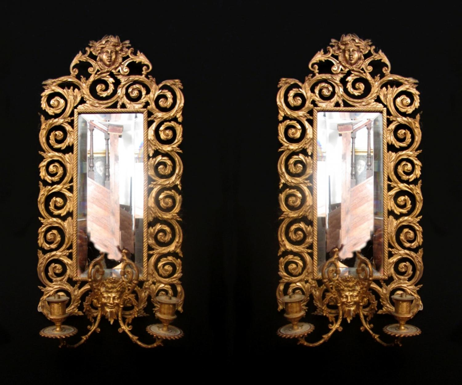 A pair of Victorian mirrored wall lights