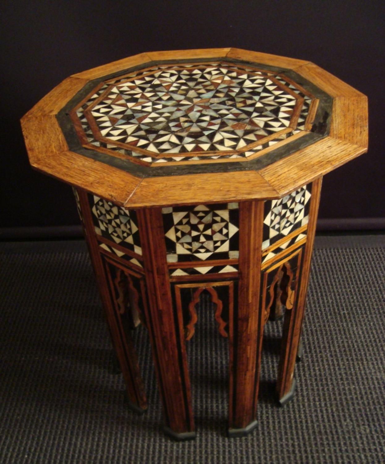 A mother of pearl and hardwood inlaid table