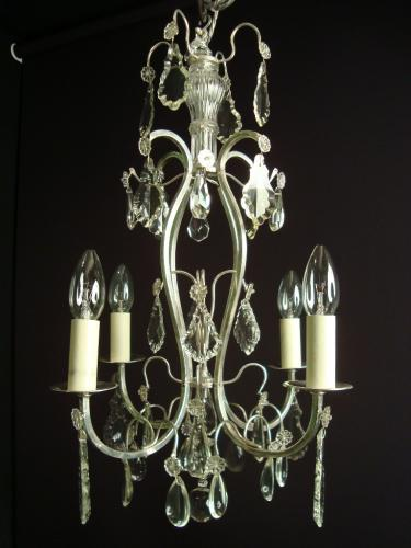 A silvered brass and crystal chandelier