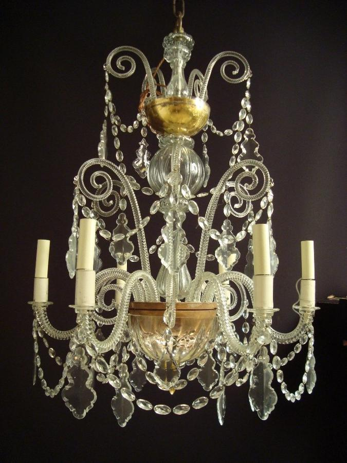 A six armed glass and gilded chandelier
