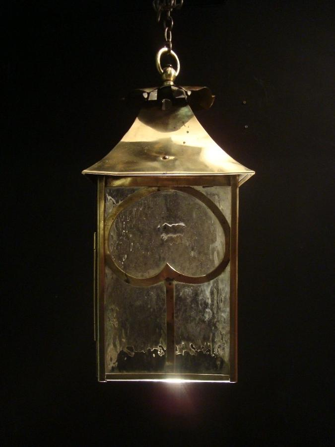 A small brass Arts and Crafts style lantern
