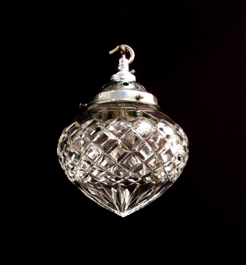 A cut glass single bulb pendent light