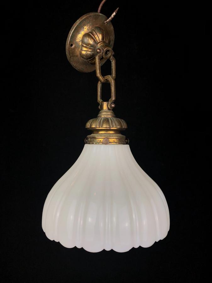 An English milk glass hanging light