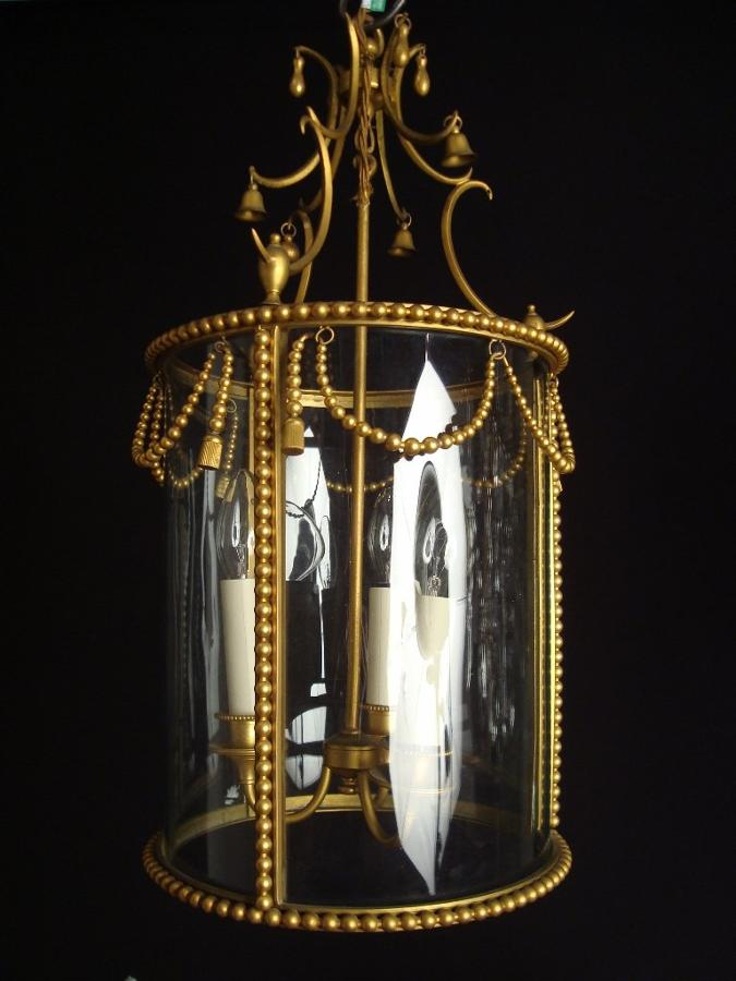 A gilt brass drum lantern