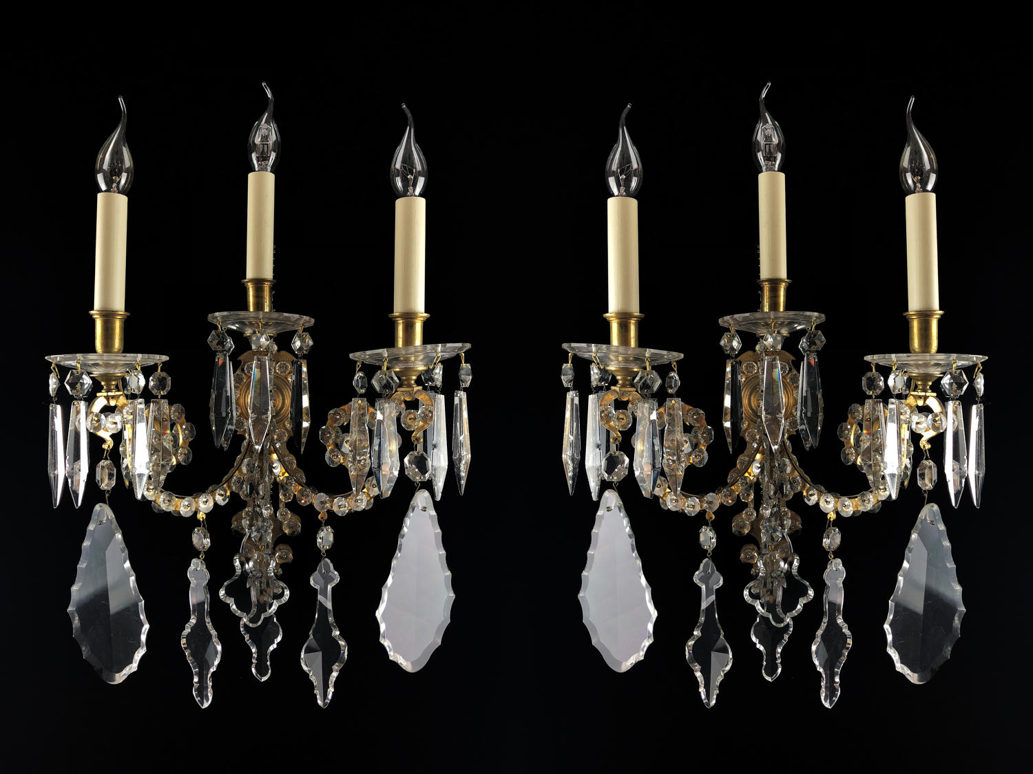 A large pair of cut glass wall lights