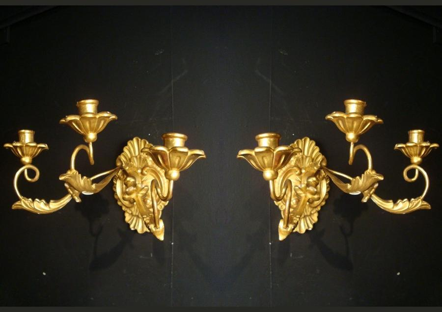 A pair of gilt wood wall lights