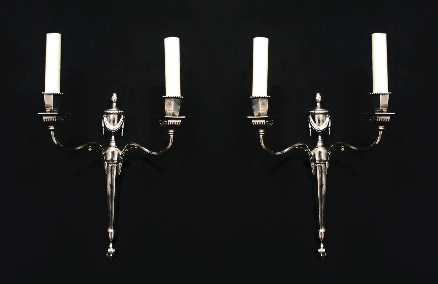 A pair of silvered neoclassical wall lights