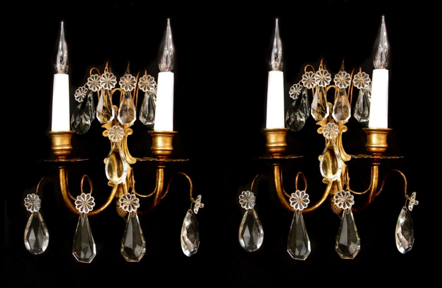 A pair of French gilt and crystal wall lights