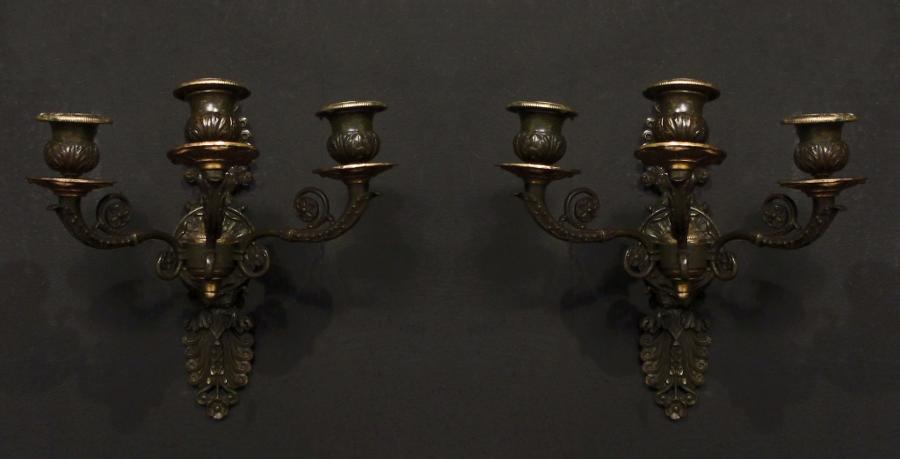 A pair of gilt patinated bronze wall lights