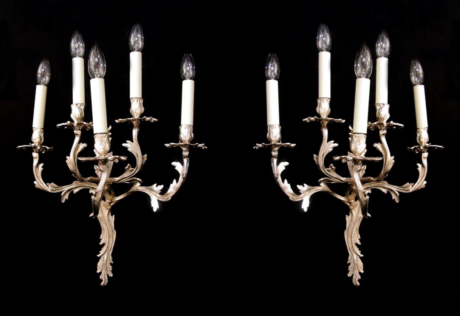 A large pair of rococo wall lights