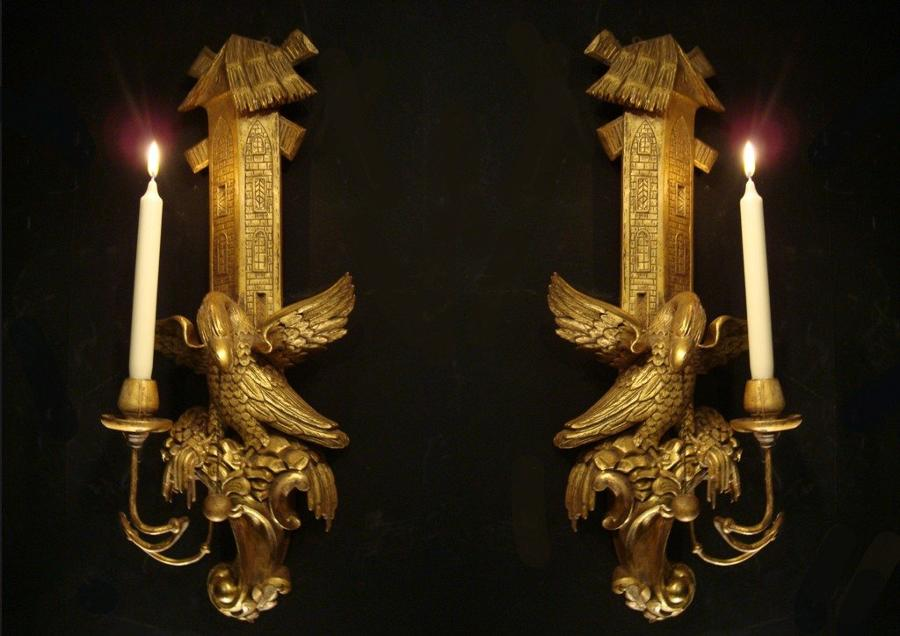 A pair of carved gilt wood wall lights