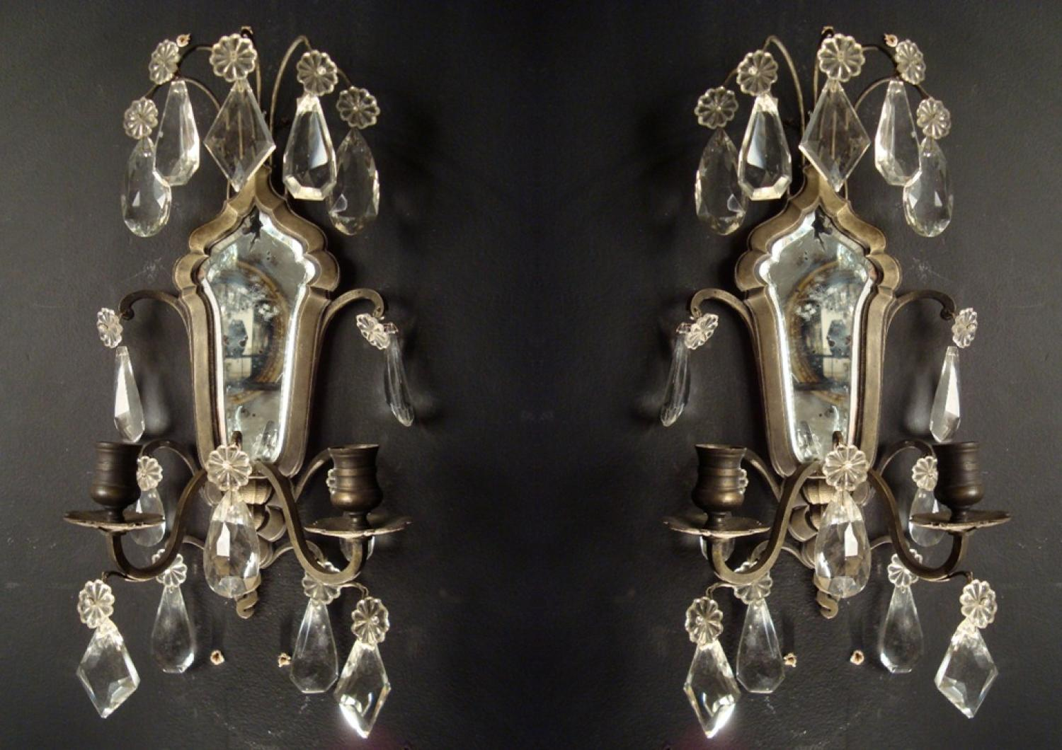 A pair of bronze and crystal wall lights