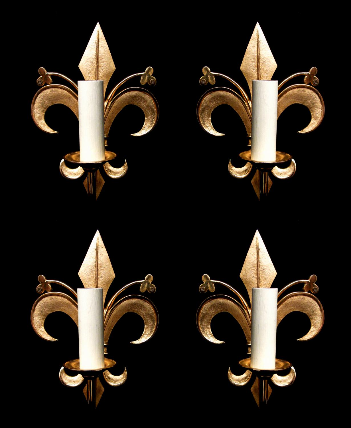 A set of 4 fleur de lis shaped wall lights