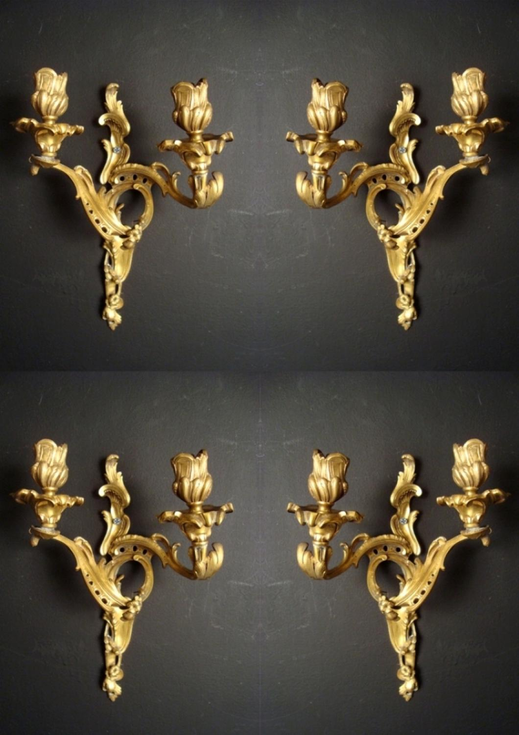 A set of four Louis XV style wall lights