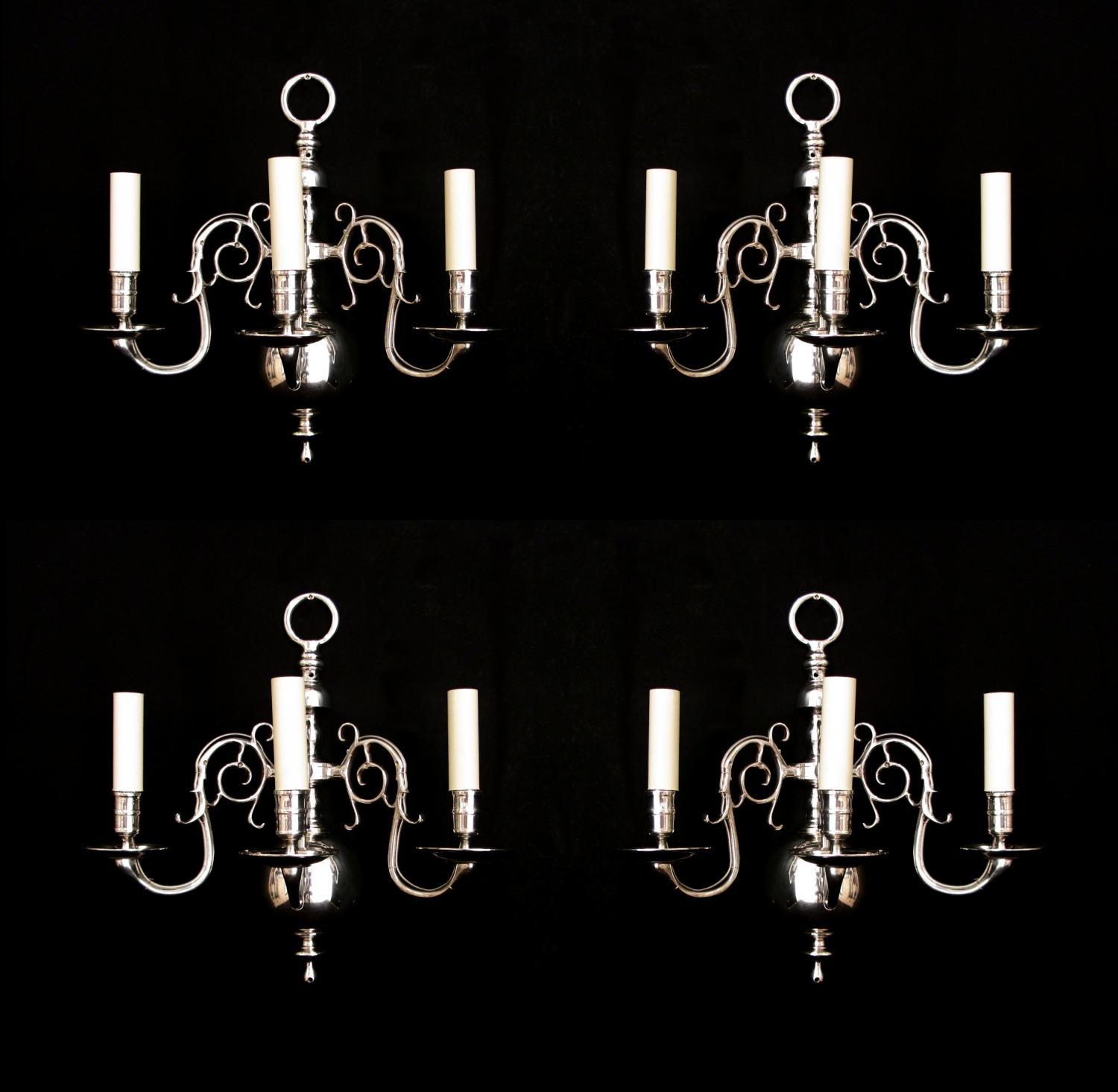 A set of 4 Dutch style silvered wall lights