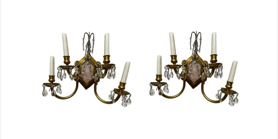 A pair of pink quartz wall lights