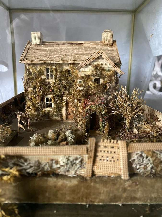 A model of a cottage Made of pinpricked wood