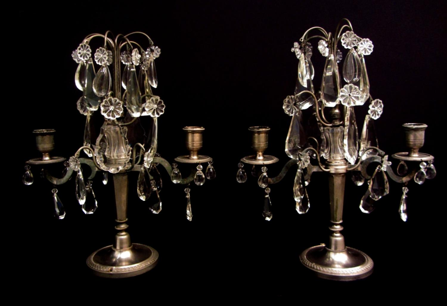 A pair of silvered and crystal girandoles