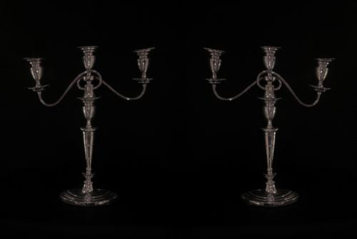 A pair of silver plated candelabras