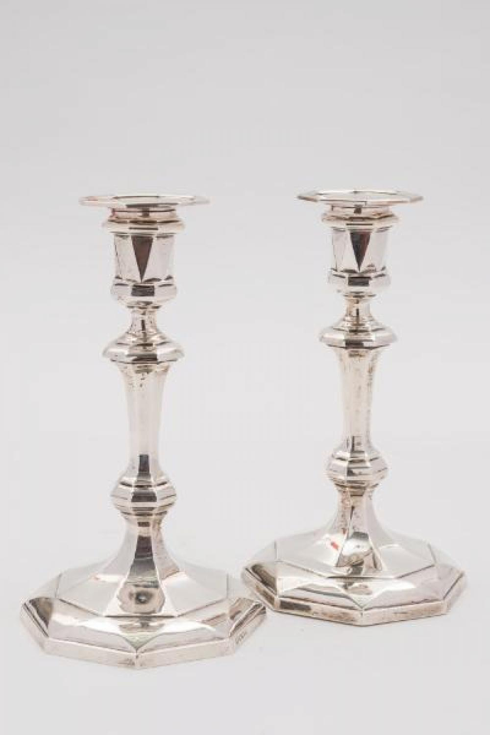 A pair of George V silver candlesticks