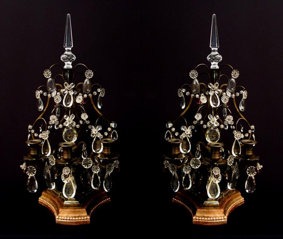 A pair of bronze and crystal girandoles