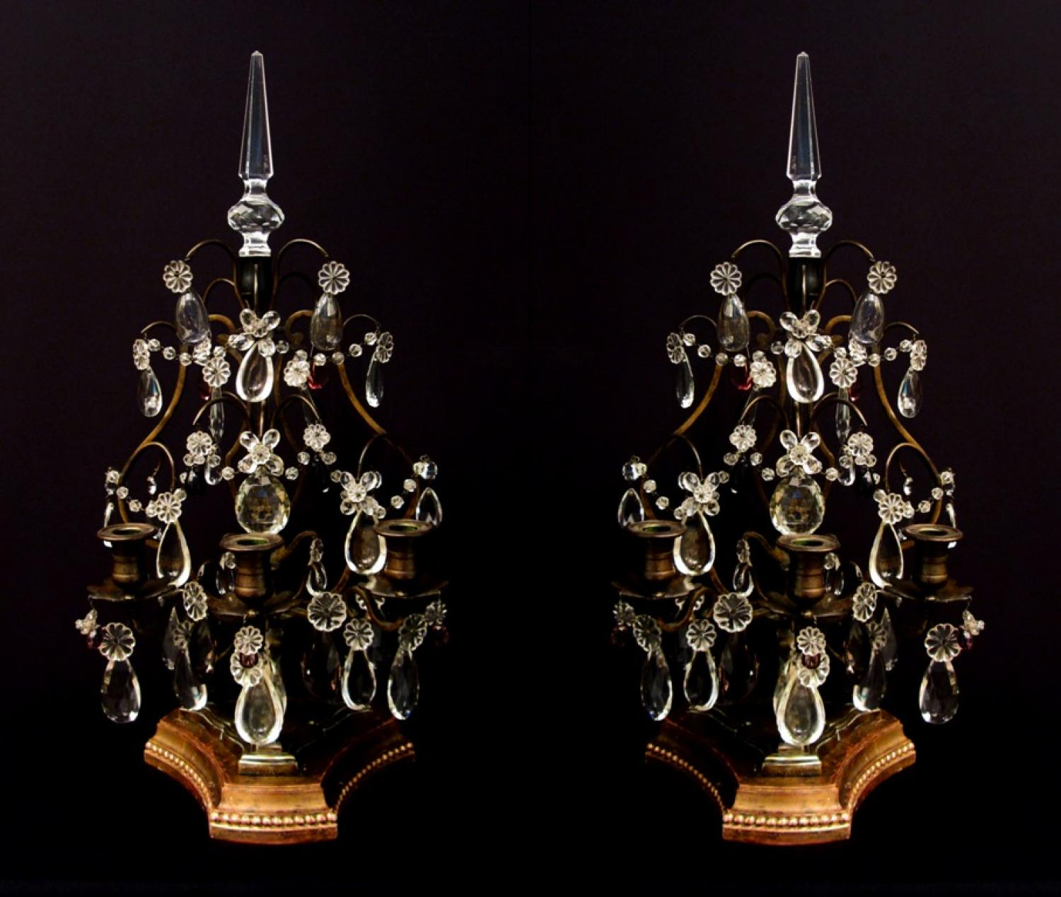 A pair of bronze and crystal girandoles