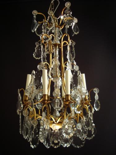 A gilt lacquered and crystal chandelier