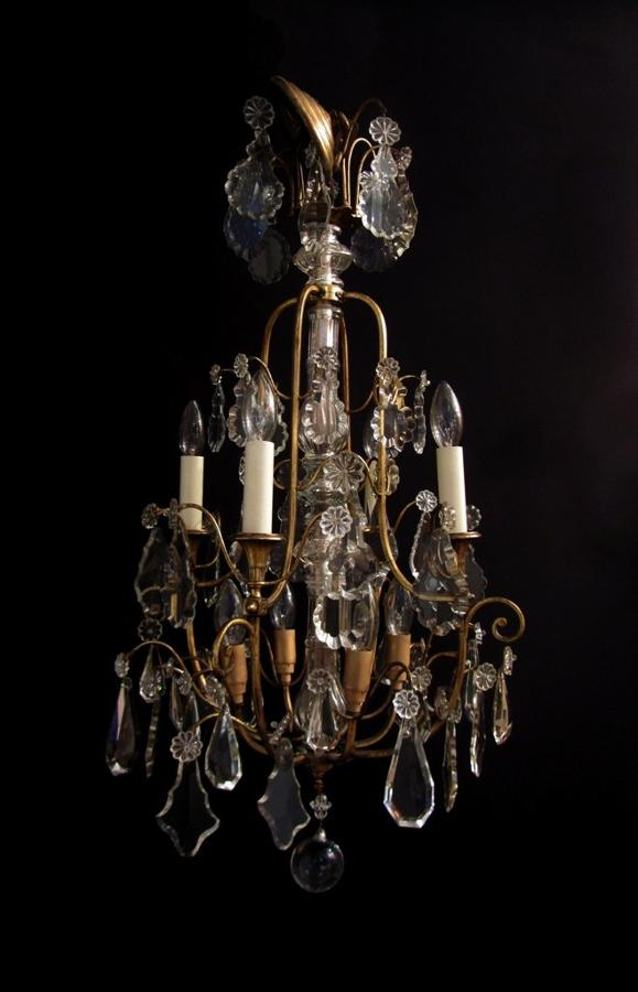 A decorative gilt lacquered brass chandelier