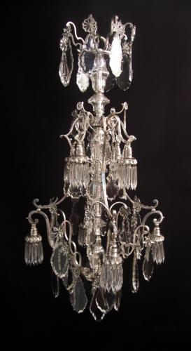 An unusual eight light silvered chandelier
