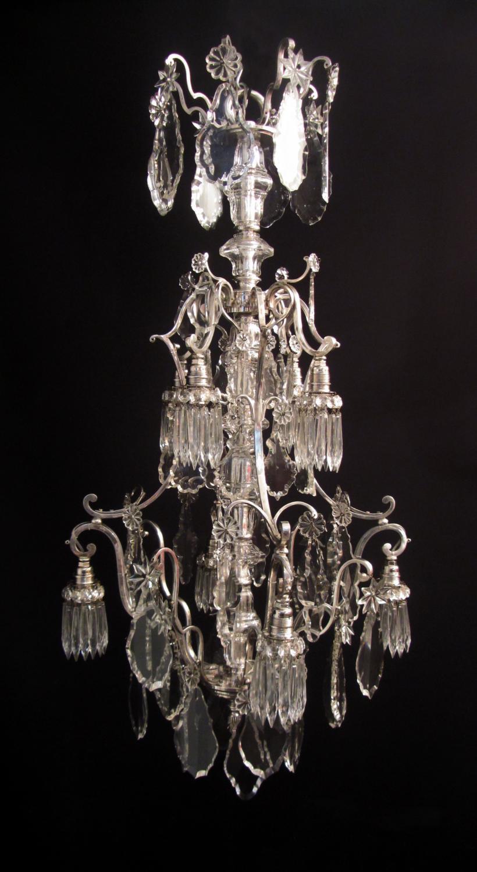 An unusual eight light silvered chandelier