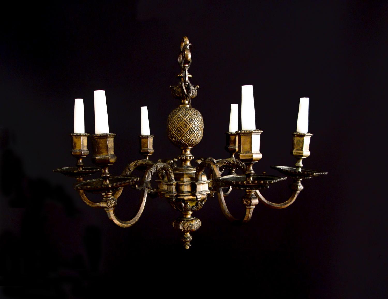 A six arm brass pineapple chandelier