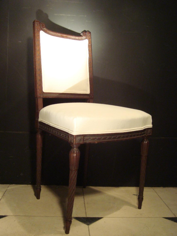 A carved dark walnut chair