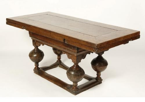 An oak draw-leaf dining table