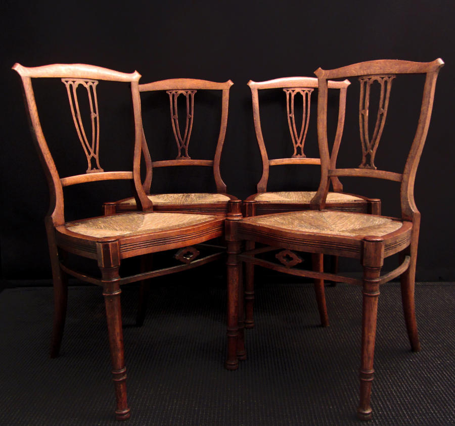 A set of four Arts and Crafts Style chairs