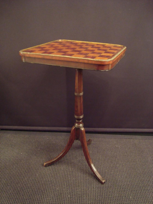 A mahogany chess table
