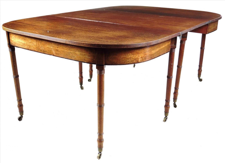 A Regency mahogany dining table