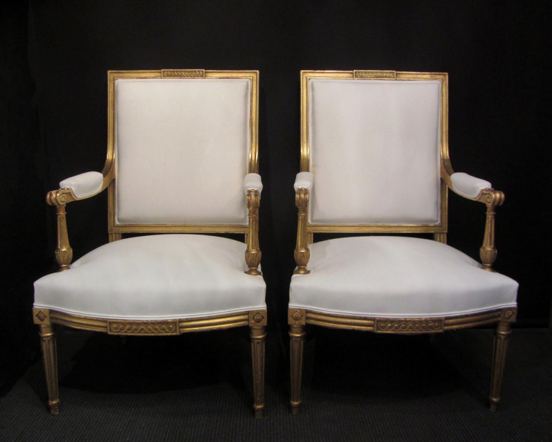 A pair of Louis XVI style fauteuils