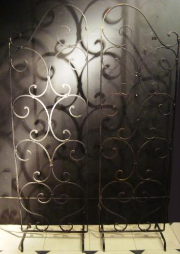 A pair of wrought iron screens