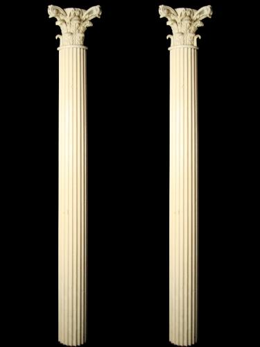 A pair of white painted carved wood pilasters