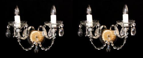 A pair of cut glass wall lights