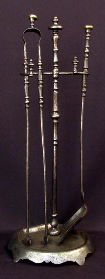 A set of polished steel fire tools