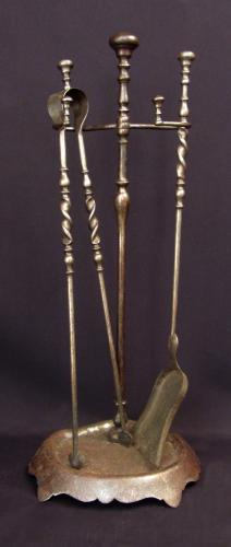A set of polished steel fire tools