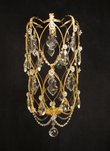 A charming gilt brass cage light