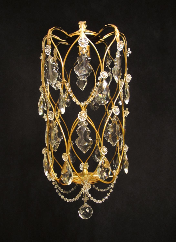 A charming gilt brass cage light
