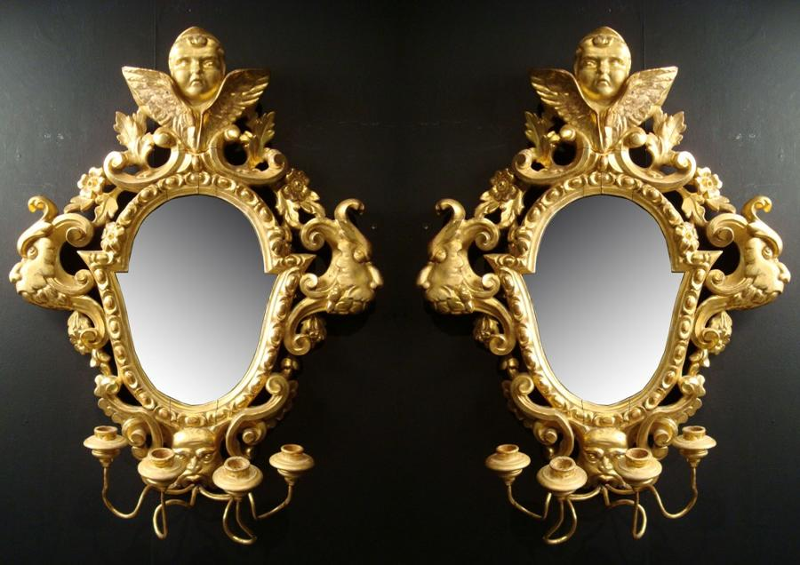 A pair of girandole mirrors