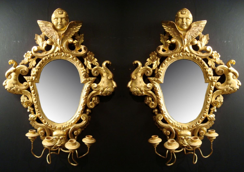A pair of girandole mirrors
