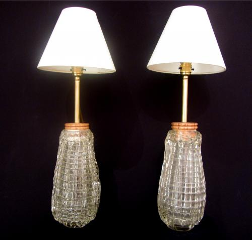 A pair of unusual glass lamps