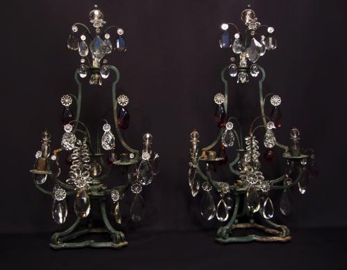 A pair of iron girandoles