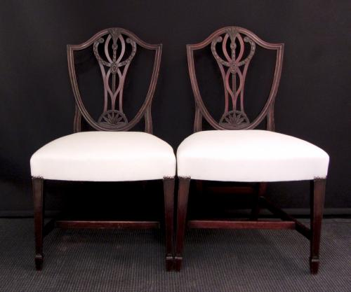 A set of eight carved mahogany dining chairs
