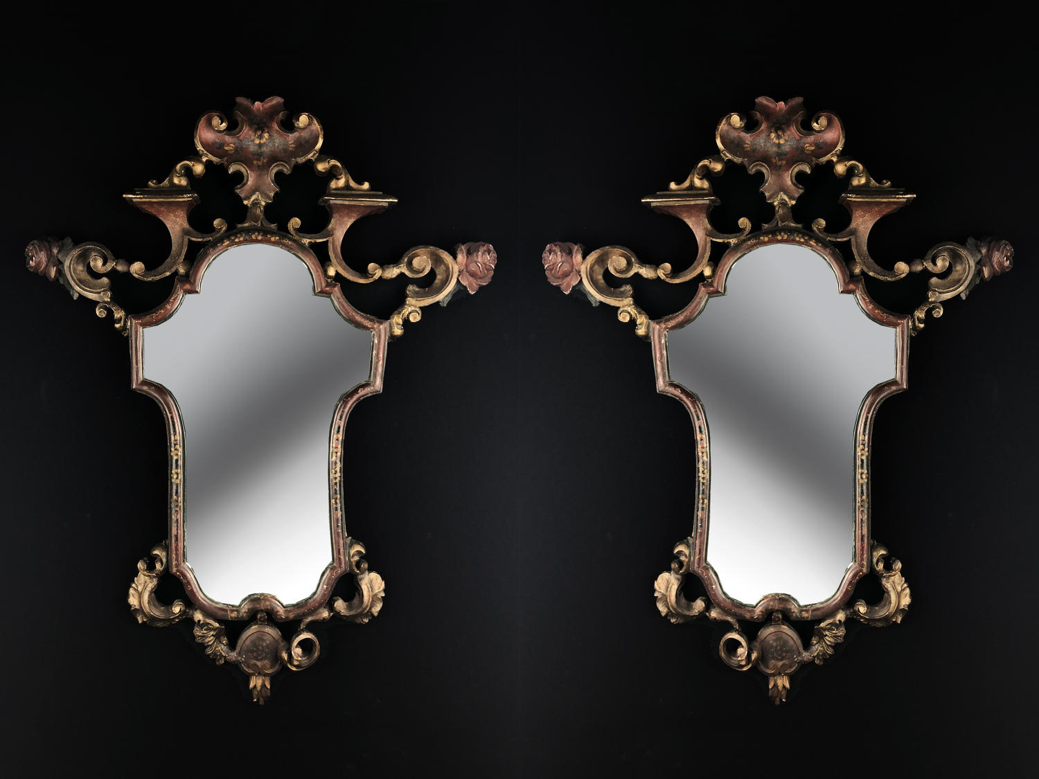 A pair of carved beech wood mirrors